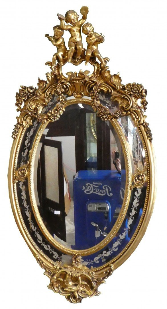 19th c French gilt wood oval mirror with cherubs