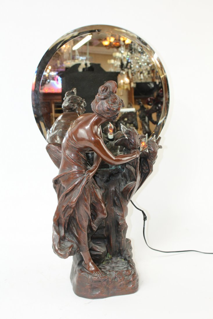 Art Nouveau bronze clad figural sculpture with mirror