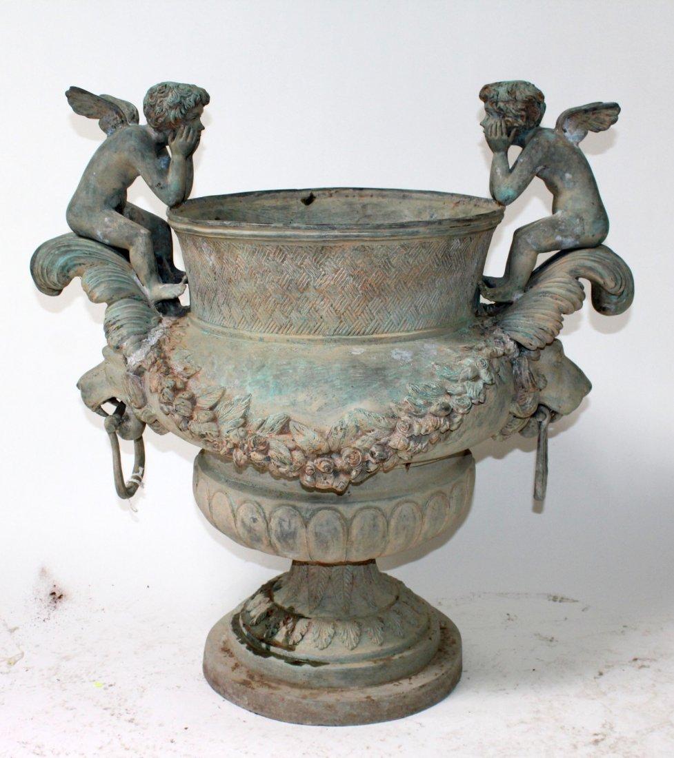 Classical verdigris bronze urn with putti