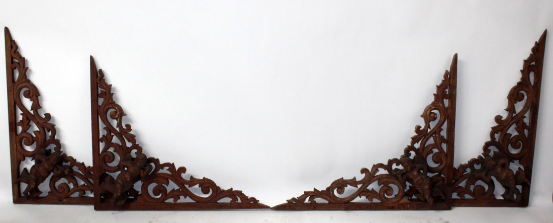 Set of 4 carved mahogany cornices with cherubs