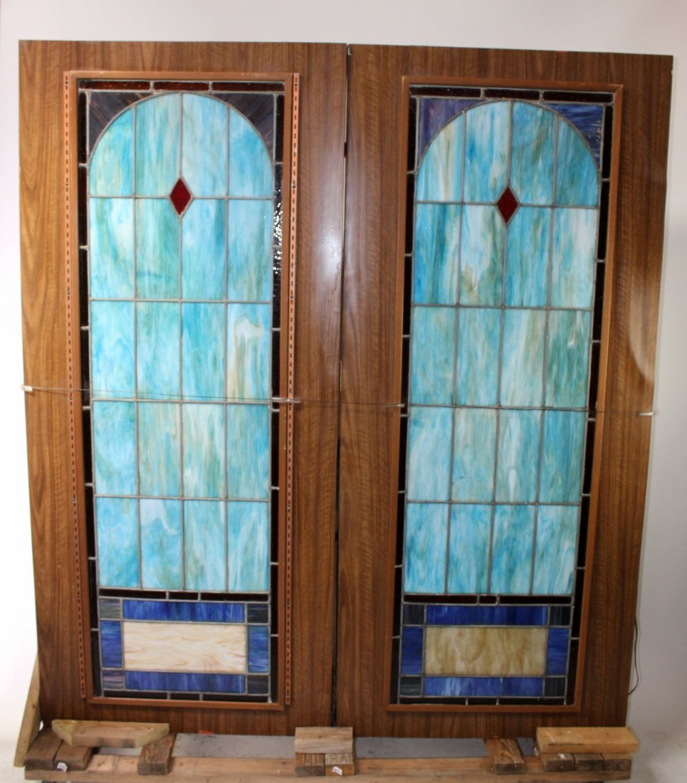Pair of Antique glass church panels in light boxes