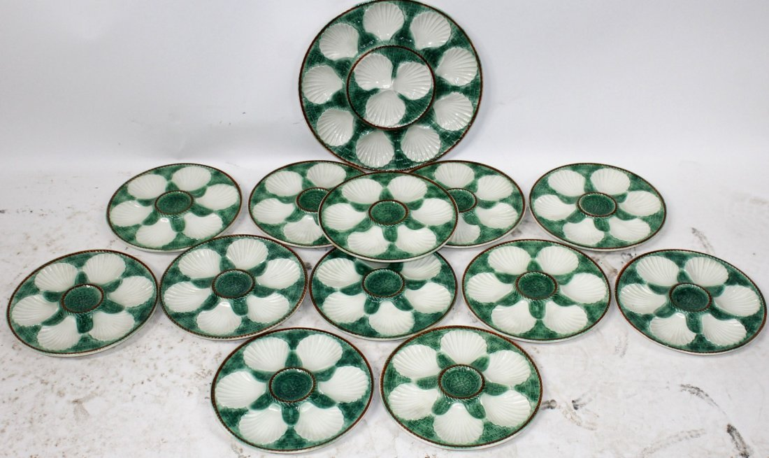 Lot of 12 French Majolica oyster plates with platter