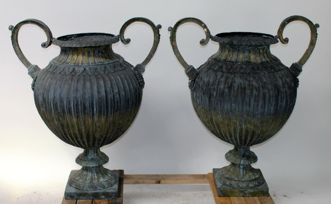 Pair of vedigris bronze pot belly urns with handles