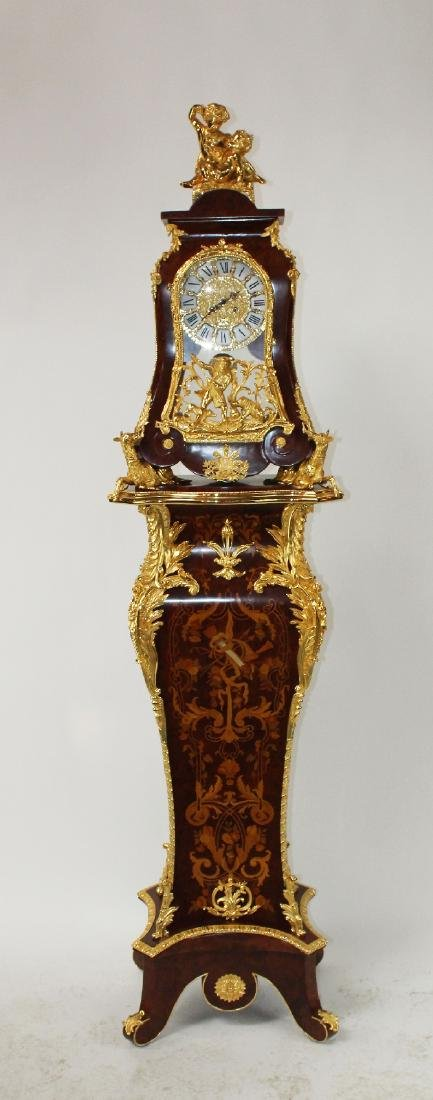 Louis XIV style dore bracket clock on pedestal
