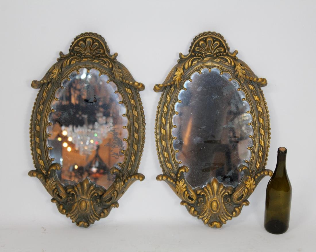 Pair of oval cast mirrors