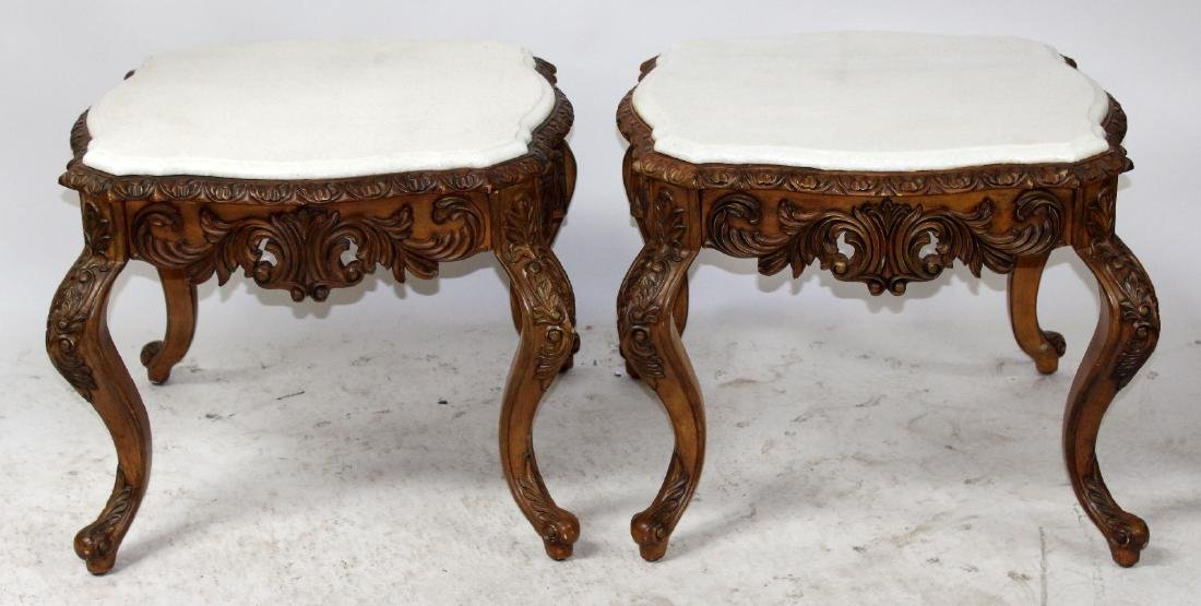 Pair of carved walnut side tables with marble tops