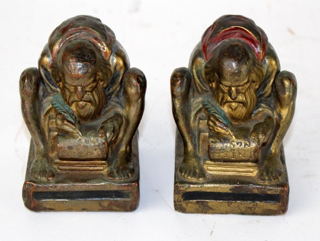 Pair of Bronze clad polychrome monk bookends