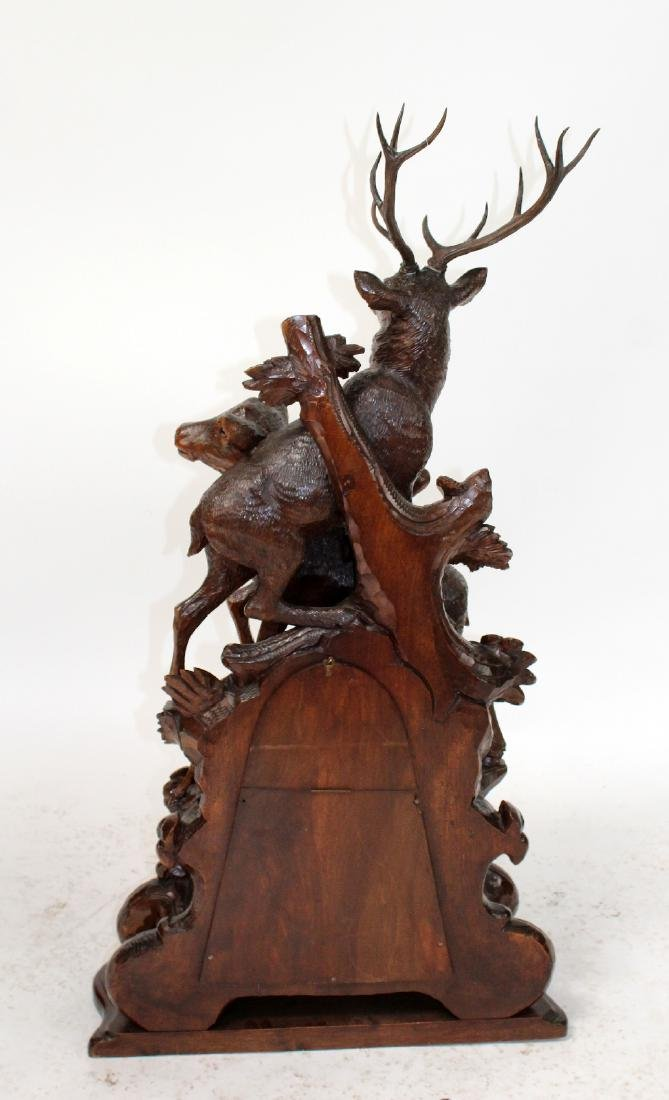 French carved Black Forest mantel clock - 2