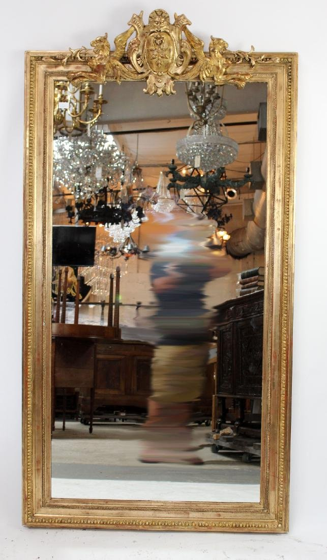 French gilt mirror with gryphons