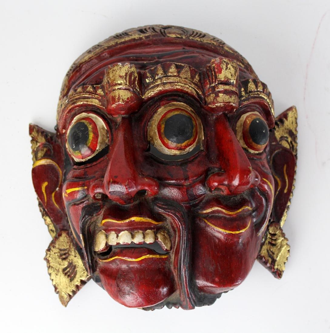 Carved wooden Tibetan mask