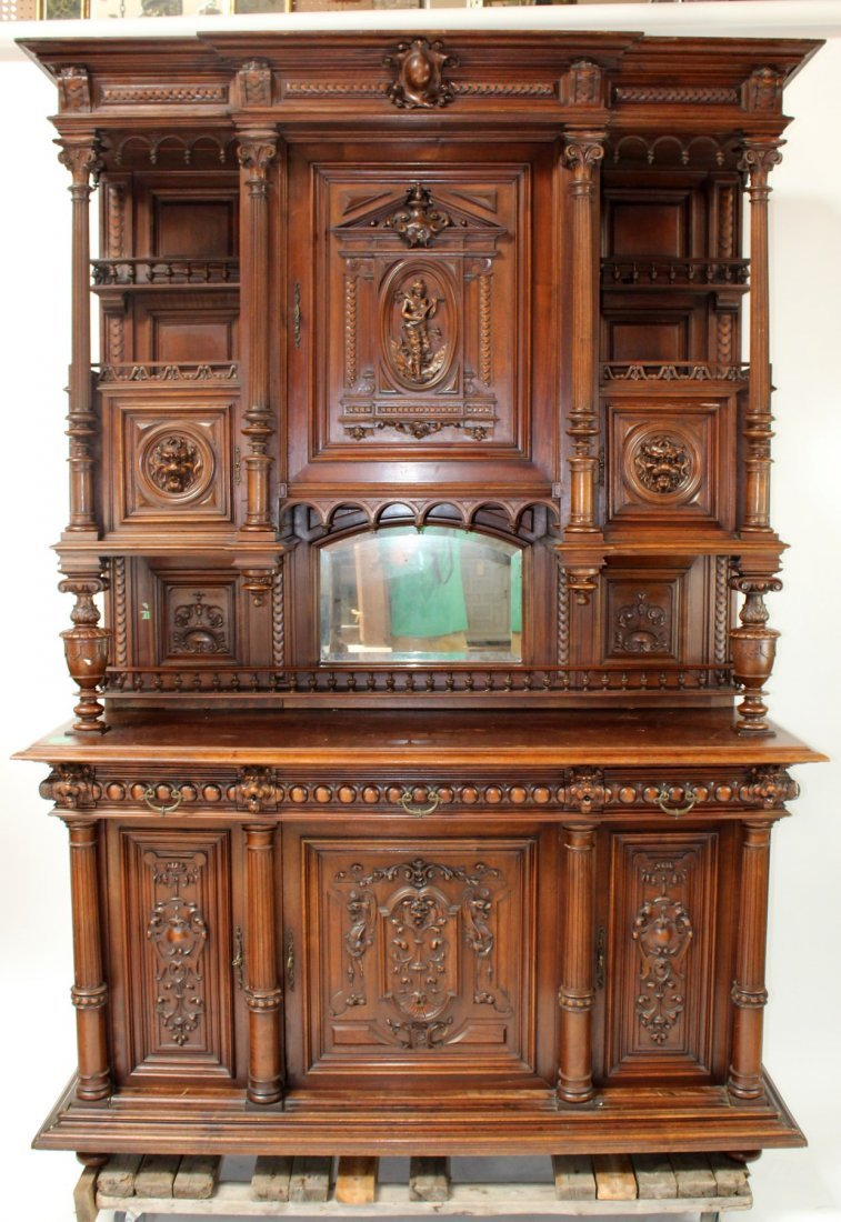 French carved walnut buffet with lion heads