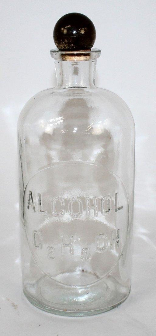 Vintage TCW Co pharmacy bottle marked Alcohol