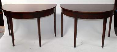 Pair of mahogany demi lune console tables