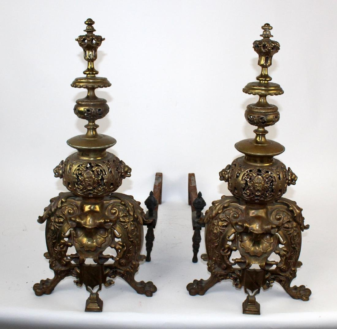 Pair of ornate brass andirons with lions