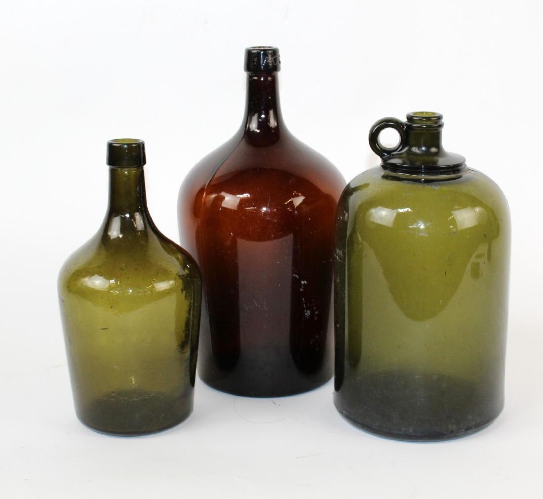 Lot of 3 green & amber glass demi john bottles