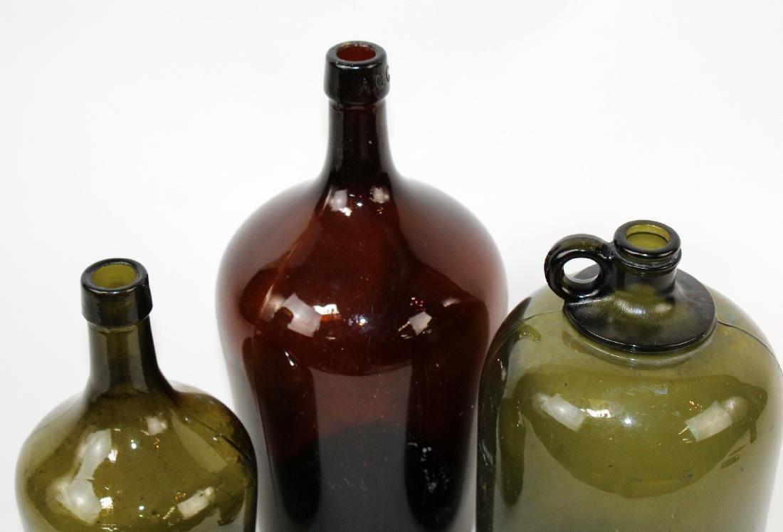 Lot of 3 green & amber glass demi john bottles - 3