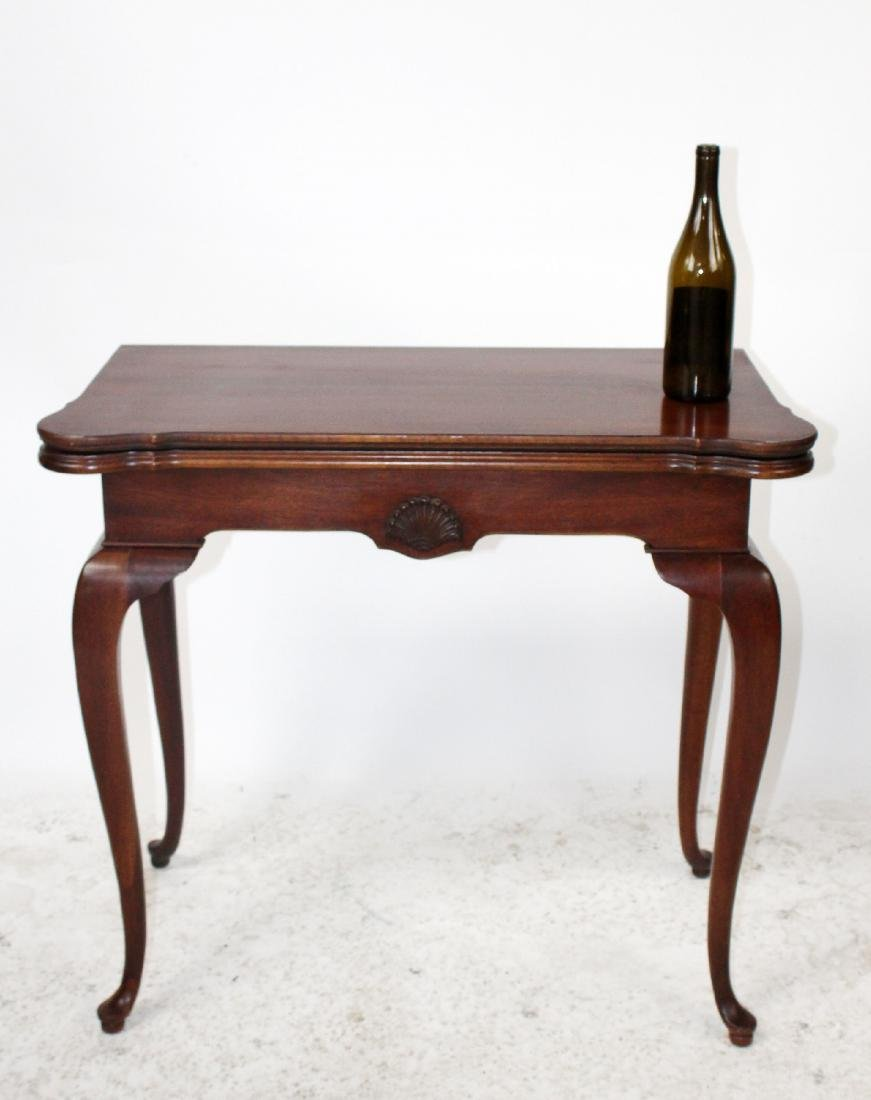 Mahogany console game table with shell carving