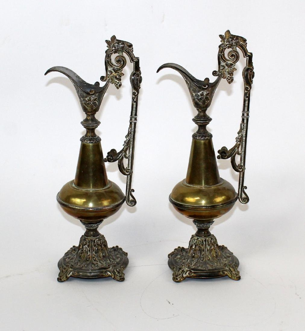 Pair brass and pewter ewers