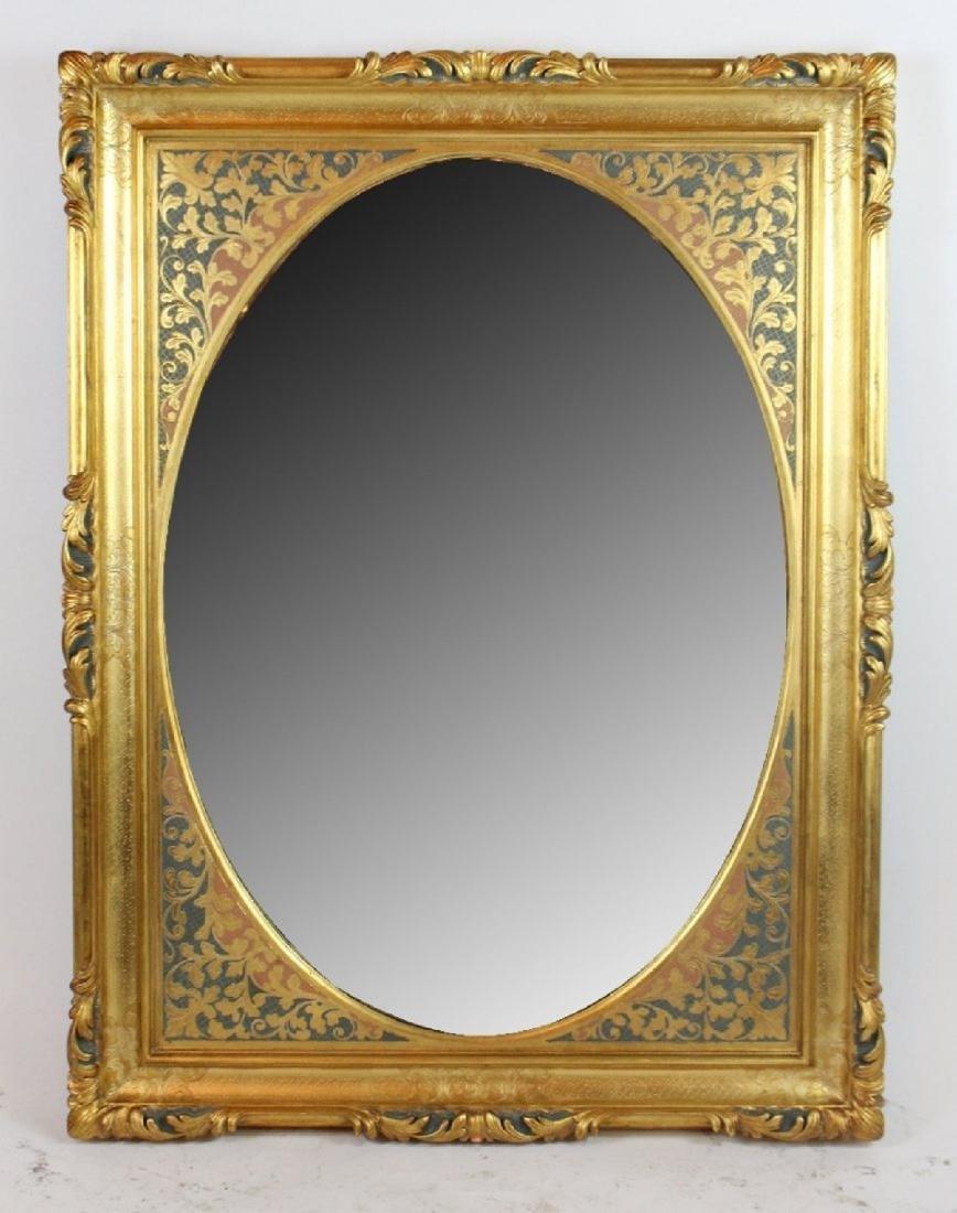 Gilt framed mirror with foliate border