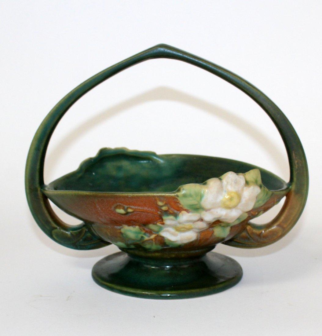 Roseville pottery white rose handled basket