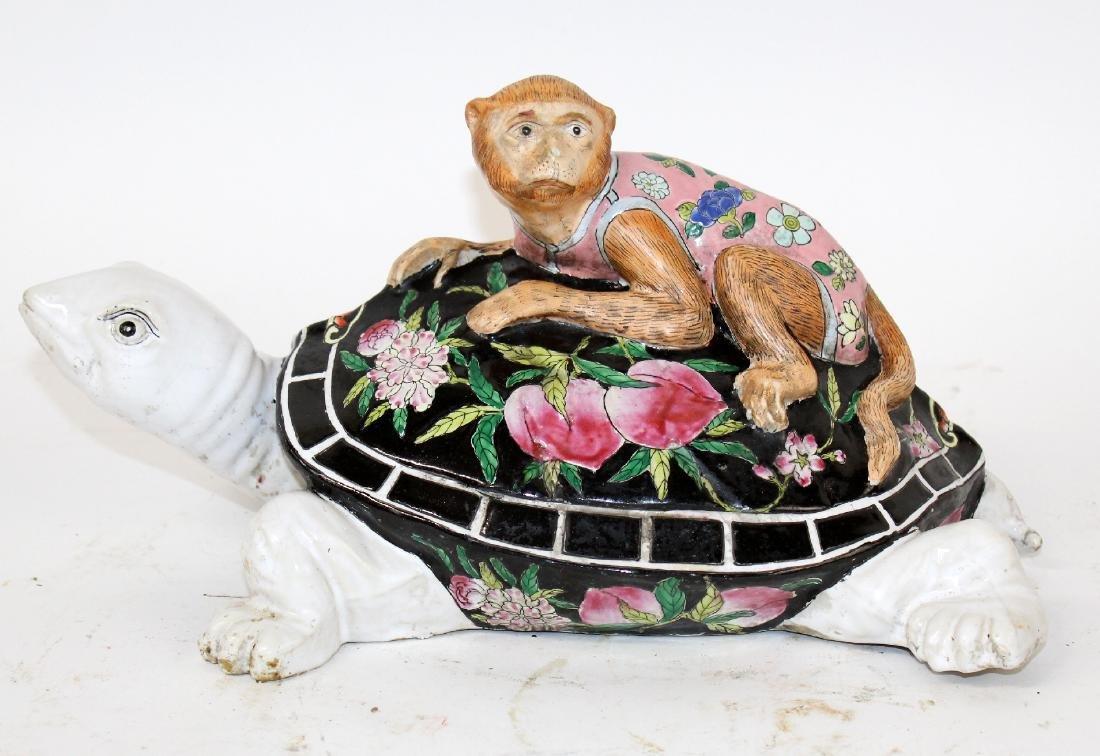 Chinese ceramic figurine monkey on turtle sculpture
