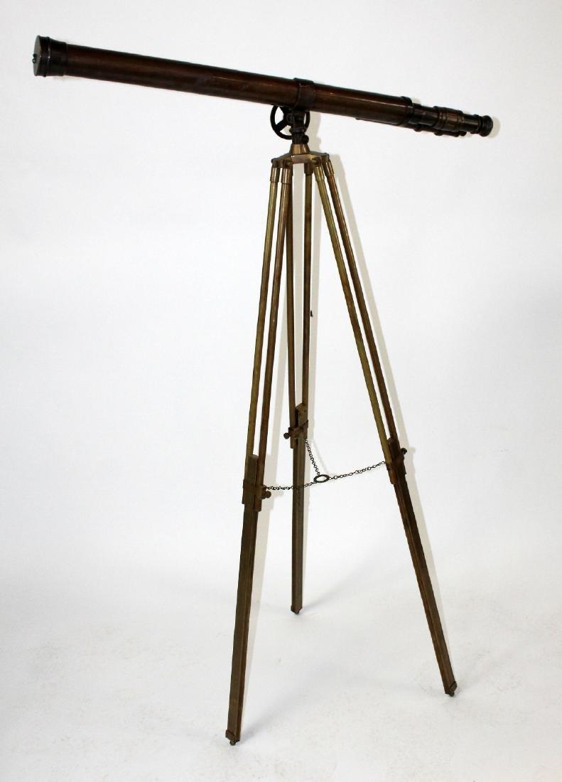 Brass telescope on tripod stand
