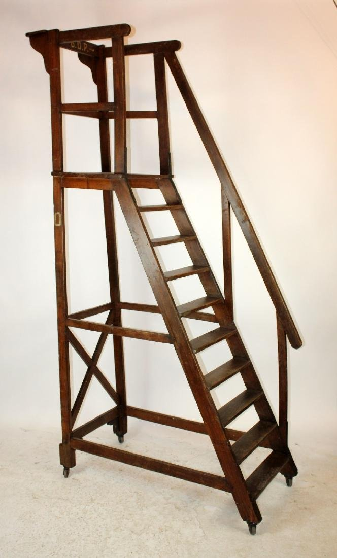 Antique French rolling library ladder