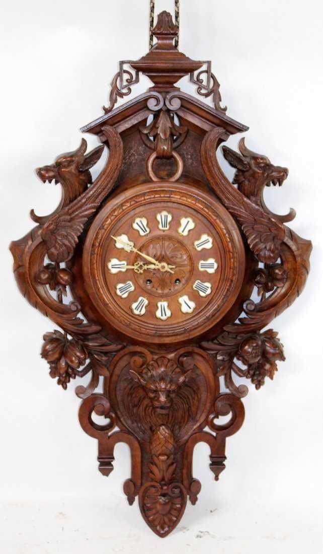 French carved walnut cartel clock