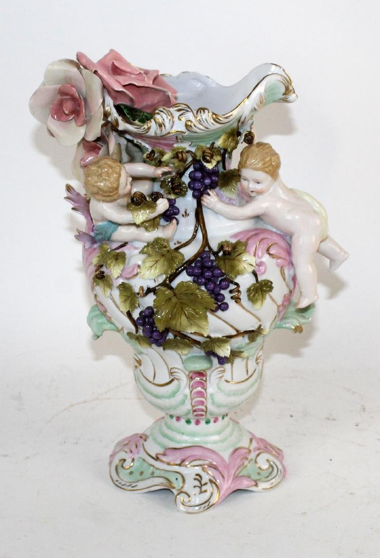 Italian porcelain vase with cherubs