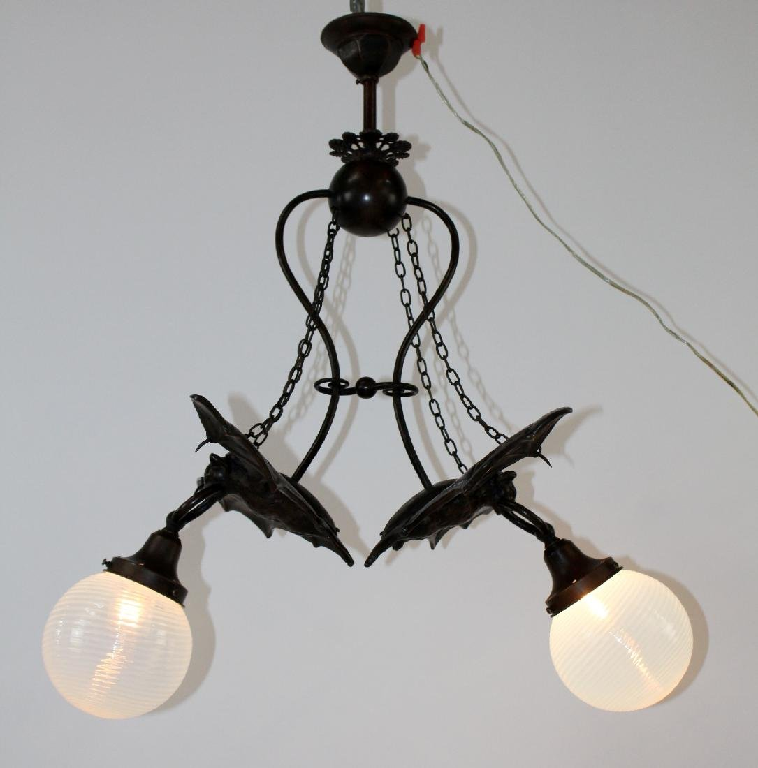 Bronze double Bat light with art glass shades