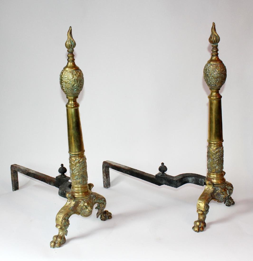 Pair of decorative brass andirons
