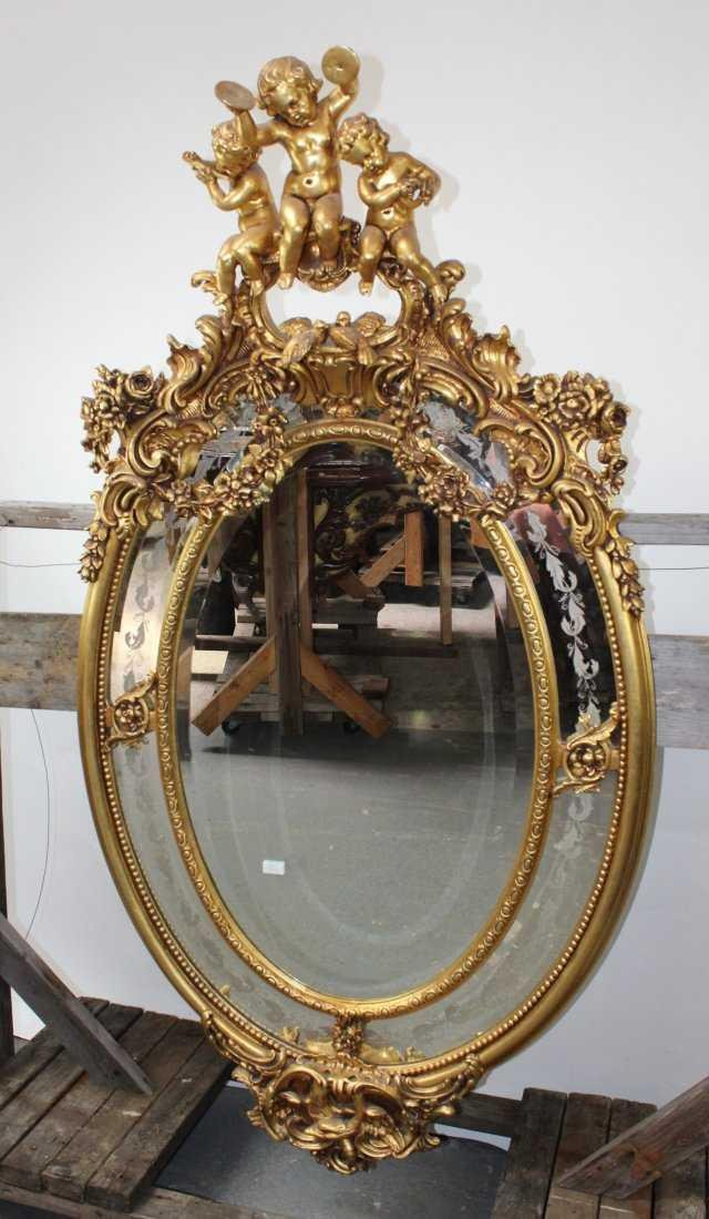 Grand scale French gilt oval parclose mirror w/ cherubs