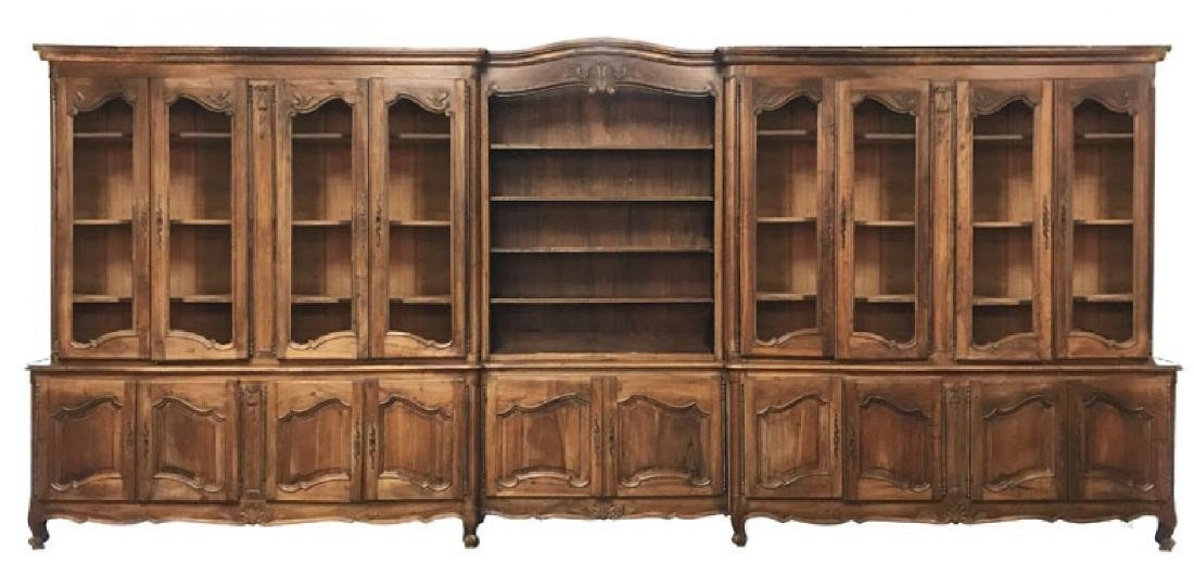 Monumental French Louis XV bookcase with glass doors