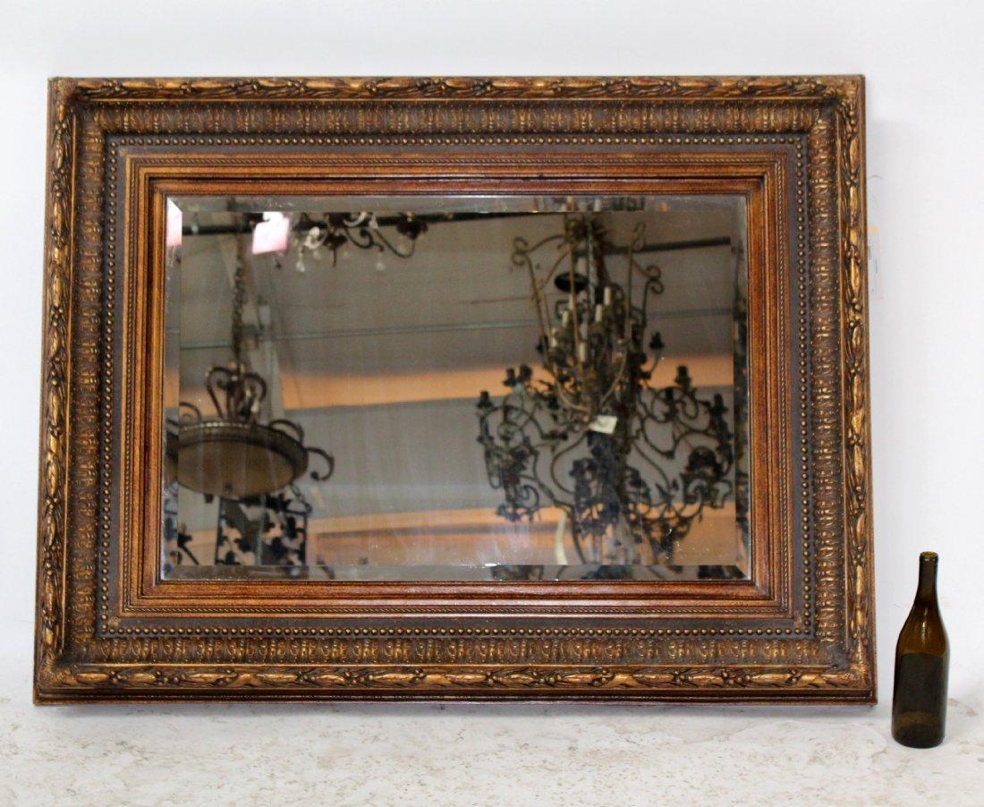Gilt framed beveled mirror