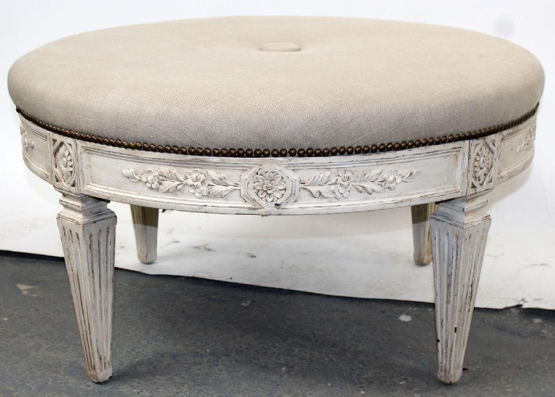 Round upholstered ottoman on legs