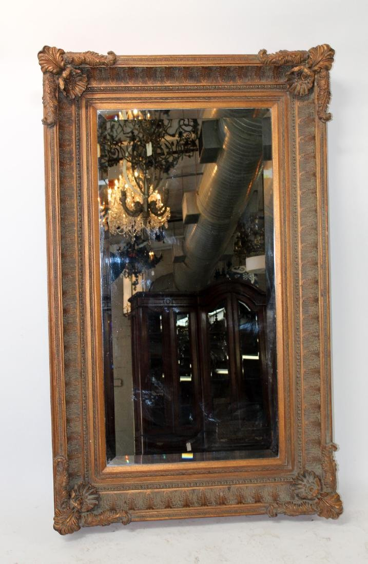 Acanthus decorated framed mirror