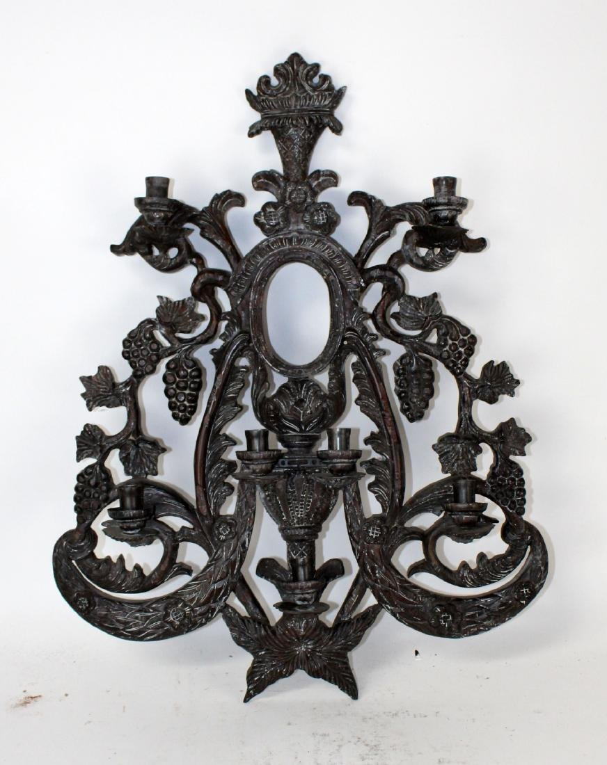 Guildmaster carved candle wall sconce