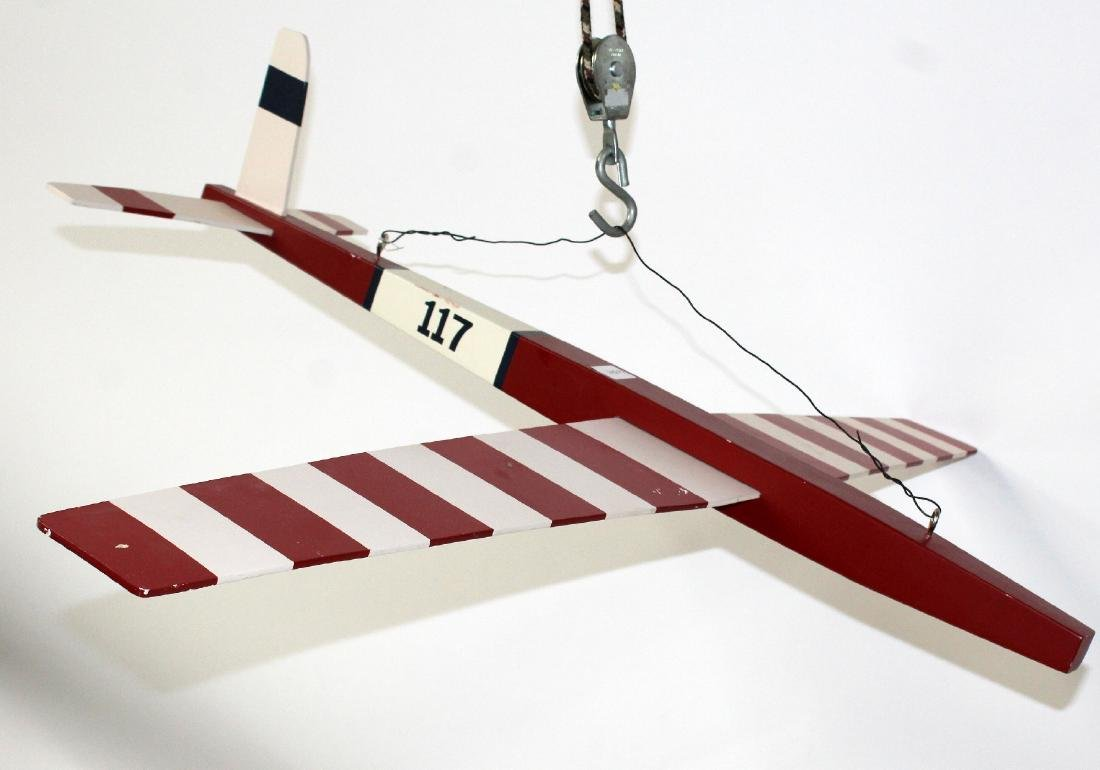 Red and white painted model airplane