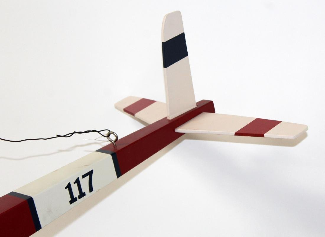 Red and white painted model airplane - 2