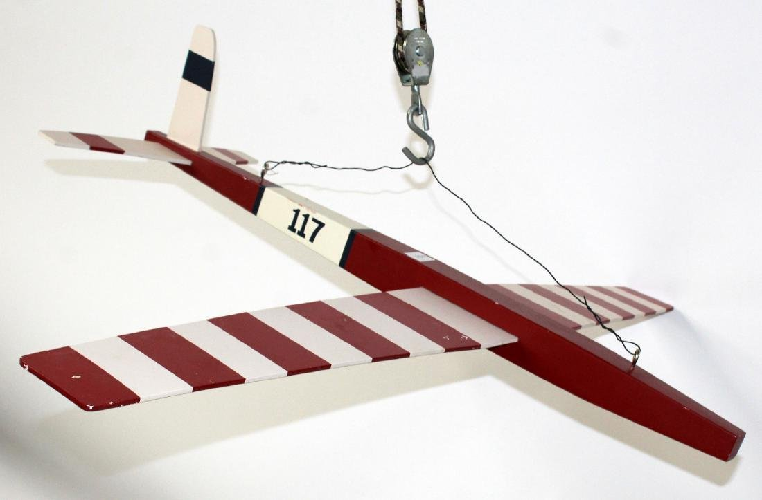 Red and white painted model airplane - 3