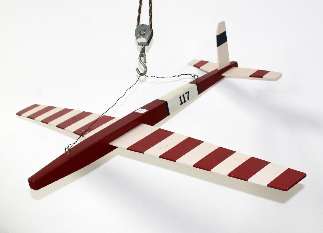 Red and white painted model airplane - 4