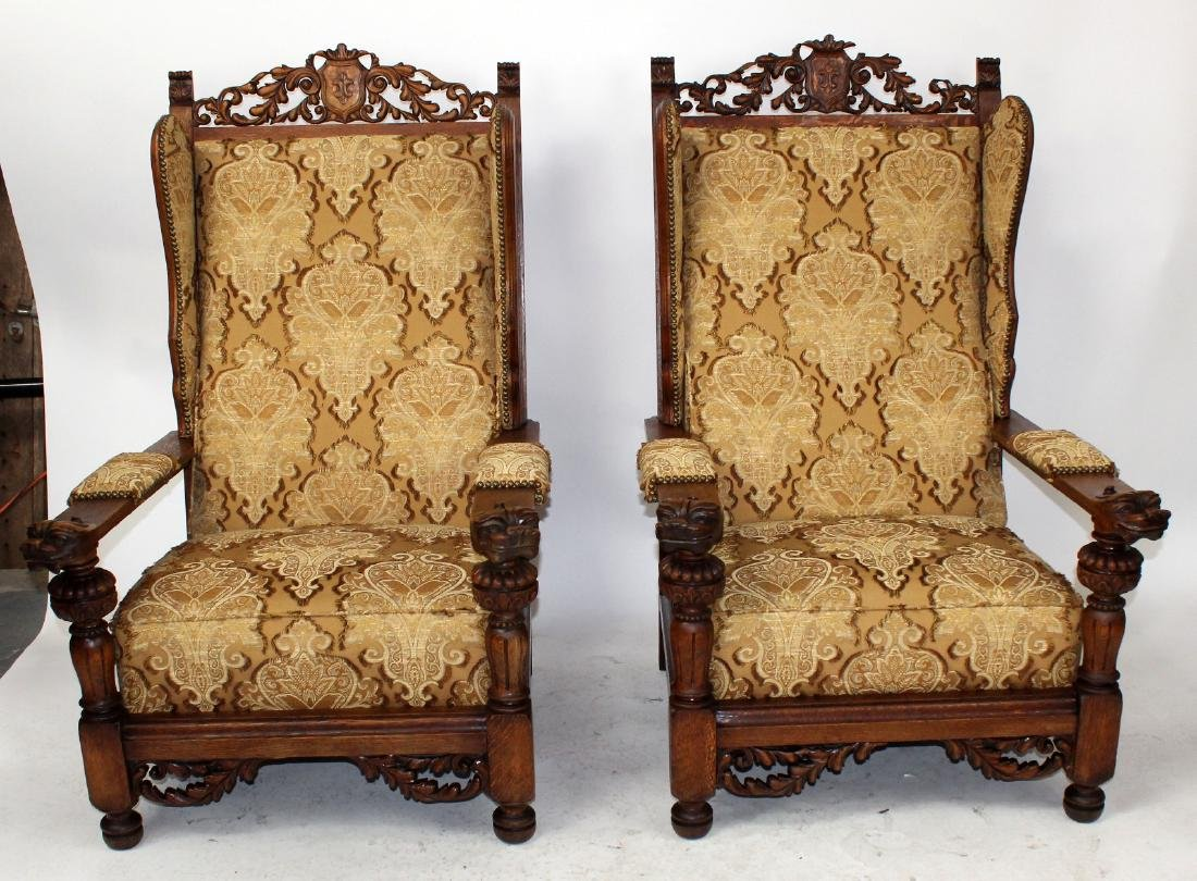 Pair of French carved oak fireside armchairs