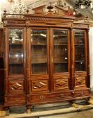 French 4door walnut bookcase with carved pediment