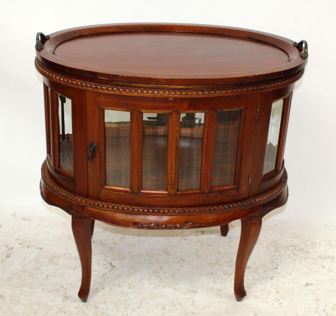Mahogany oval chocolate cabinet