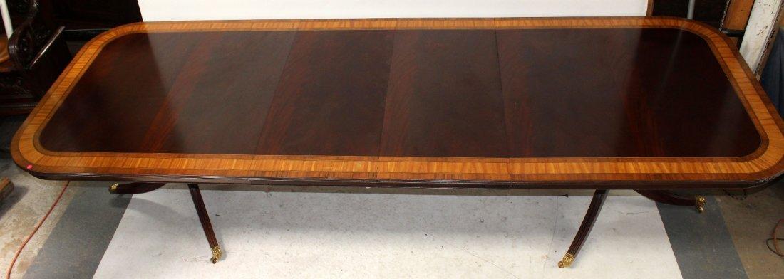 Banded mahogany double pedestal base dining table