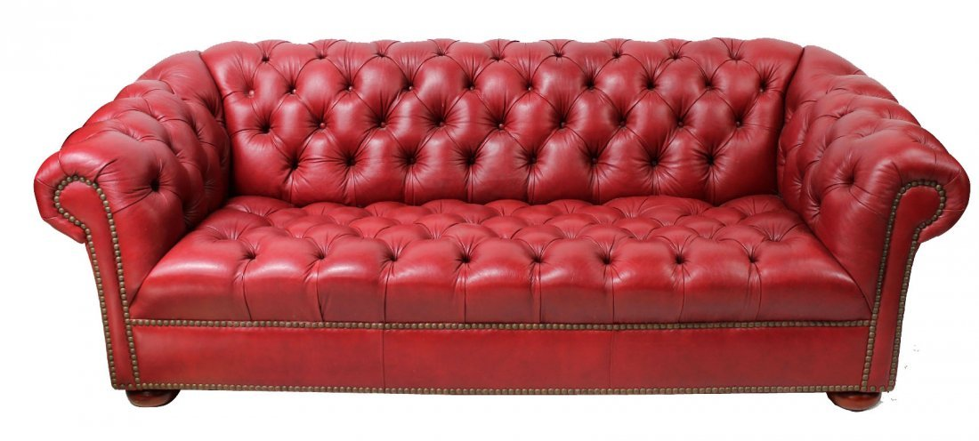 Studded red leather chesterfield sofa