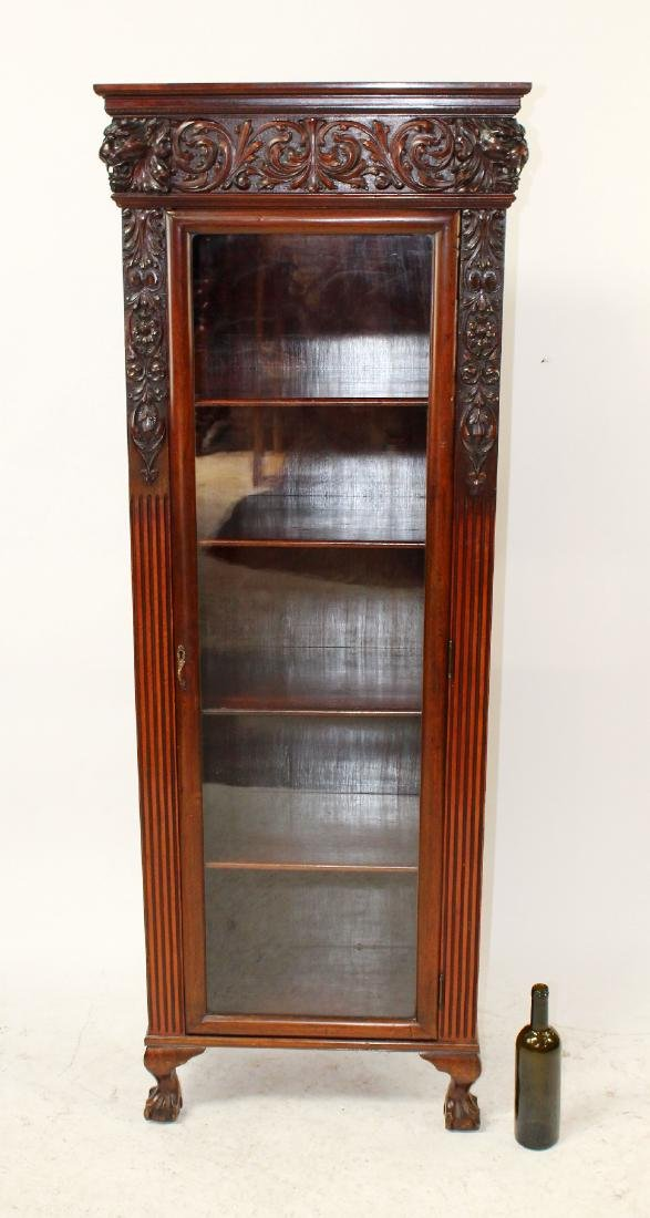 French carved walnut bookcase with lions