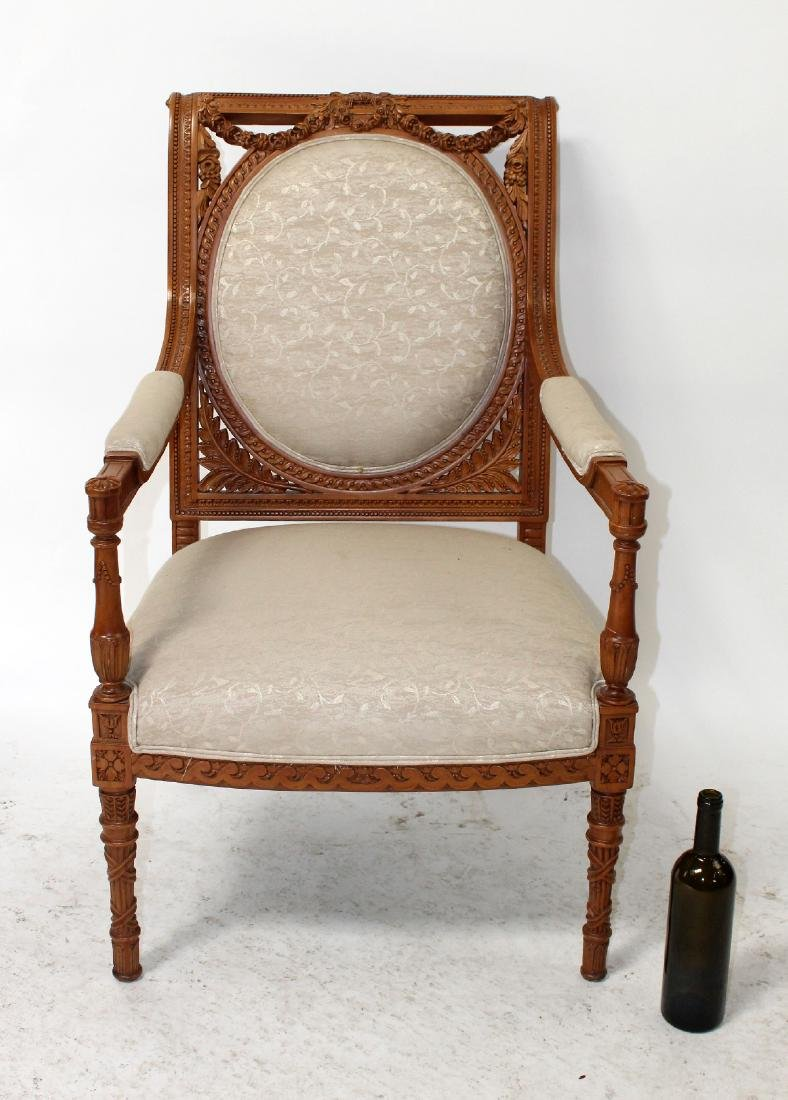 Louis XVI style carved armchair