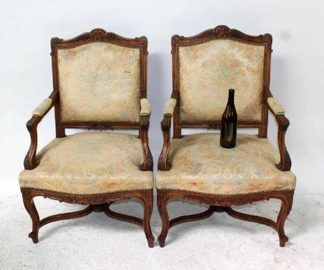 French Louis XV style carved walnut bergere armchairs