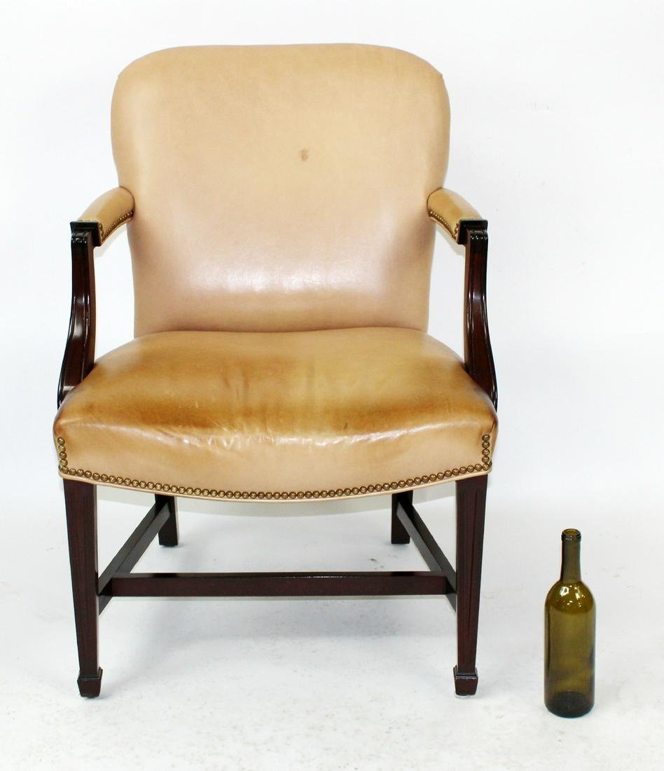 Tan leather upholstered armchair